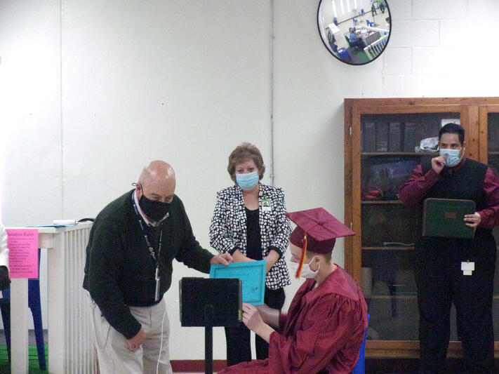 Student-inmate shows off diploma virtually to family on video call